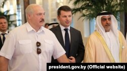 Belarusian President Alyaksandr Lukashenka (left) is welcomed upon his arrival at the Presidential Airport in Abu Dhabi on November 1.