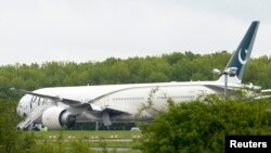 A Pakistan International Airlines Boeing 777 aircraft is seen parked on the tarmac at Stansted Airport on May 24.