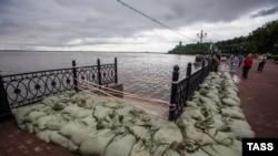 Protective sandbags are piled up as a precaution against the Amur River bursting its banks in Khabarovsk on August 19.
