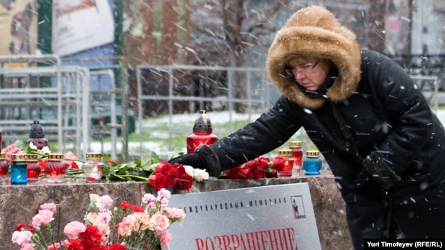 A woman pays tribute to the victims of Soviet repression on Lubyanka Square in Moscow.