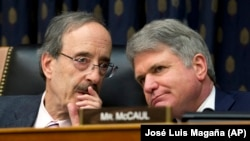 In this archive photo of February 13, 2019, the President of the Foreign Affairs Committee of the House of Representatives, Democrat Eliot Engel (L) talking with his Republican colleague Michael McCaul, during a hearing in Washington.