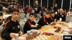 FILE - Young chess stars in Iran during a tournament. Undated