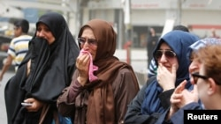 Gratë duke shprehur pikëllim pas sulmit në Bagdad