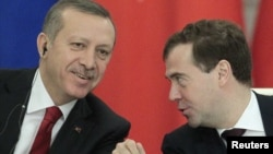 Turkish Prime Minister Recep Tayyip Erdogan (left) and Russian President Dmitry Medvedev speak at a news conference in Moscow.