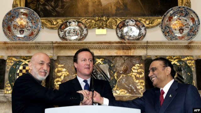 U.K. Prime Minister David Cameron (center) shakes hands with Afghan President Hamid Karzai (left) and Pakistani President Asif Ali Zardari (right) at Chequers, his official country residence, near Aylesbury in Buckinghamshire on February 4.