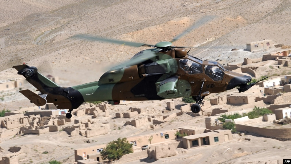 Residents of the Turkmen village of Marchak say that the sound of gunfire to the south in Afghanistan is becoming routine and that military helicopters have been regularly flying overhead as they apparently patrol the border (file photo)