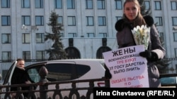 A protester stands outside the Defense Ministry in Moscow on March 8.