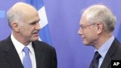 Јоргос Папандреу и Херман ван Ромпуј