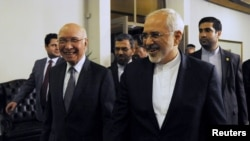 Advisor to Pakistan's Prime Minister on National Security and Foreign Affairs Sartaj Aziz (L) escorts Iranian Foreign Minister Javad Zarif before their meeting at the Foreign Ministry in Islamabad on April 8.