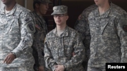 U.S. Army Pfc. Bradley Manning (center) is escorted by military police from the courthouse after a hearing at Fort Meade, Maryland, in December.