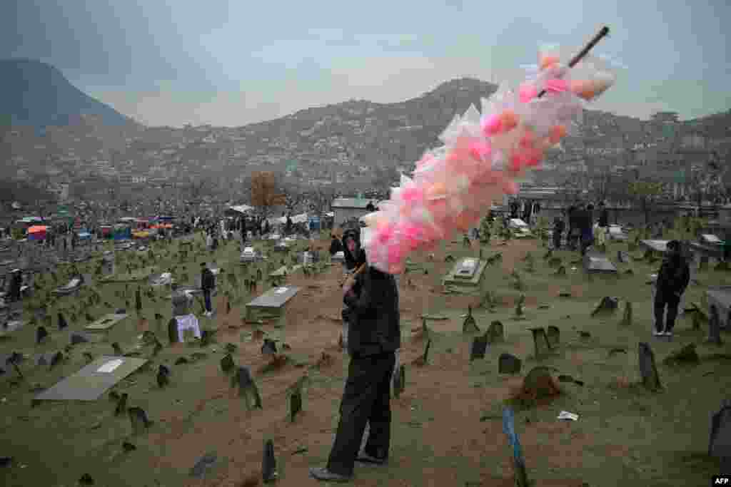 A column of cotton candy offers a flash of color to the landscape of Kabul, Afghanistan, during Norouz festivities on March 21.