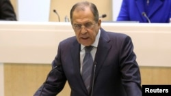Russian Foreign Minister Sergei Lavrov makes a speech to the upper house of parliament in Moscow on December 18.