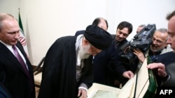 Iranian Supreme Leader Ayatollah Ali Khamenei (center) receives a copy of an ancient manuscript of the Koran from Russian President Vladimir Putin (left) during their November 23 meeting in Tehran.