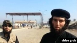 A screen grab from an Islamic State recruitment video showing a Tajik national (right) identified as Abu Umariyon.