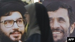 Portraits of Hezbollah Secretary-General Sheikh Hassan Nasrallah (left) and Iranian President Mahmud Ahmadinejad at an annual Koran exhibition in Tehran in 2007.