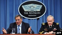U.S. Defense Secretary Leon Panetta (left) speaks as Chairman of the Joint Chiefs of Staff General Martin Dempsey looks on during a press conference announcing major defense budget cuts in Washington on January 26.