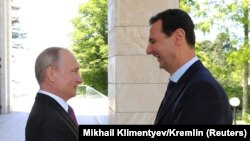 Russian President Vladimir Putin (left) welcomes Syrian President Bashar al-Assad during their meeting in the Black Sea resort of Sochi in May.