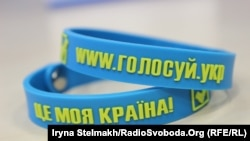 Bracelets distributed in Ukraine to encourage young voters to take part in the May 25 presidential election.