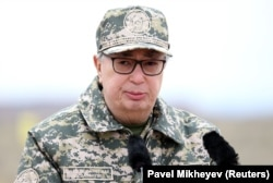 Interim Kazakh President Qasym-Zhomart Toqaev delivers a speech as he attends military exercises in the Almaty region on May 3.