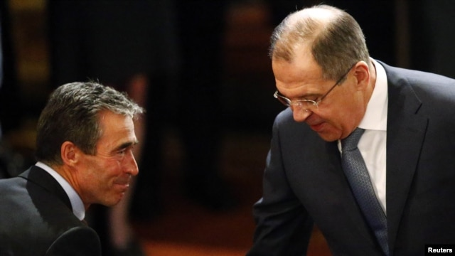 Russian Foreign Minister Sergei Lavrov (right) and NATO Secretary-General Anders Fogh Rasmussen meet at the 49th Conference on Security Policy in Munich on February 2.