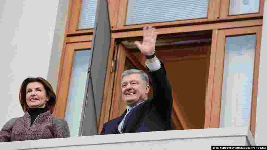 "Outgoing Ukrainian President Petro Poroshenko and his wife, Maryna, greet people from the balcony of his office where supporters had gathered to chant ""Thank You"" on April 22."