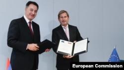 ԵՄ հանձնակատար Յոհանես Հան, Հայաստանի էկոնոմիկայի նախարար Կարեն Ճշմարիտյան