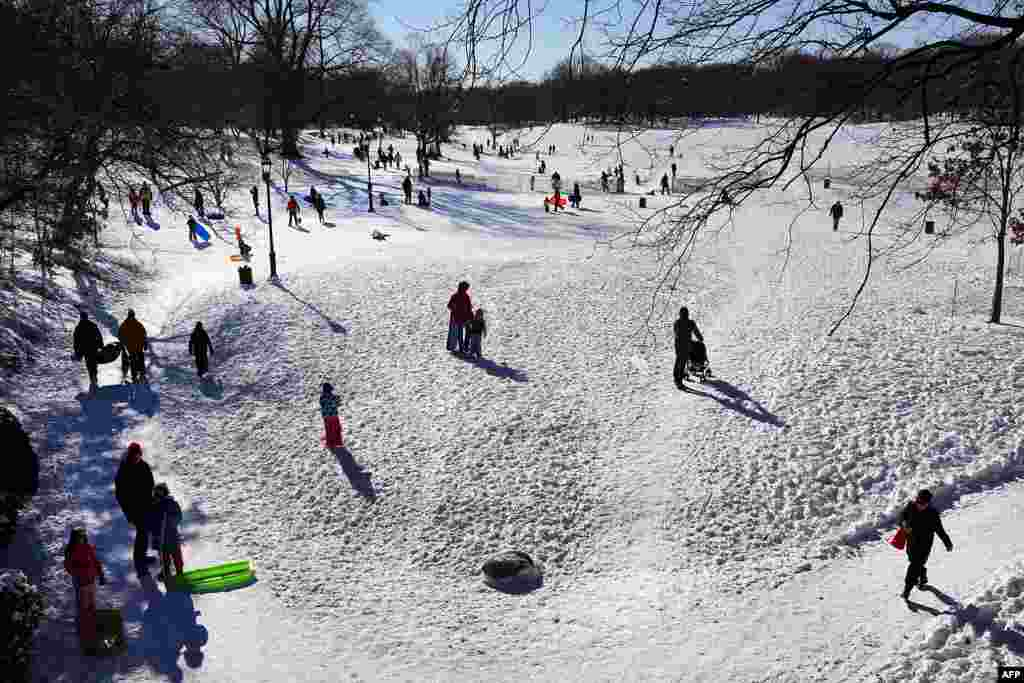 People go sledding Prospect Park in New York's Brooklyn borough after a snowstorm.