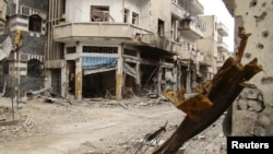 Damaged buildings in the old city of Homs on March 30