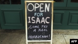U.S. -- A bar advertises its 'hurricane' drinks while remaining open in the French Quarter in New Orleans, Louisiana, 28Aug2012