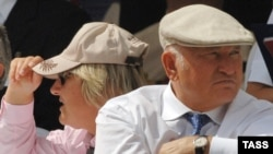 Moscow Mayor Yury Luzhkov (right) and his wife, Yelena Baturina, at the Russian President's Cup horse races in July 2006