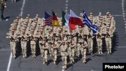 Armenia - Armenian soldiers carry U.S., German, Italian, Polish and Greek flags during a parade in Yerevan, 21Sep2016.