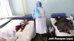 Afghans who were injured in a U.S. air strike receive medical treatment at a hospital in Herat in August.