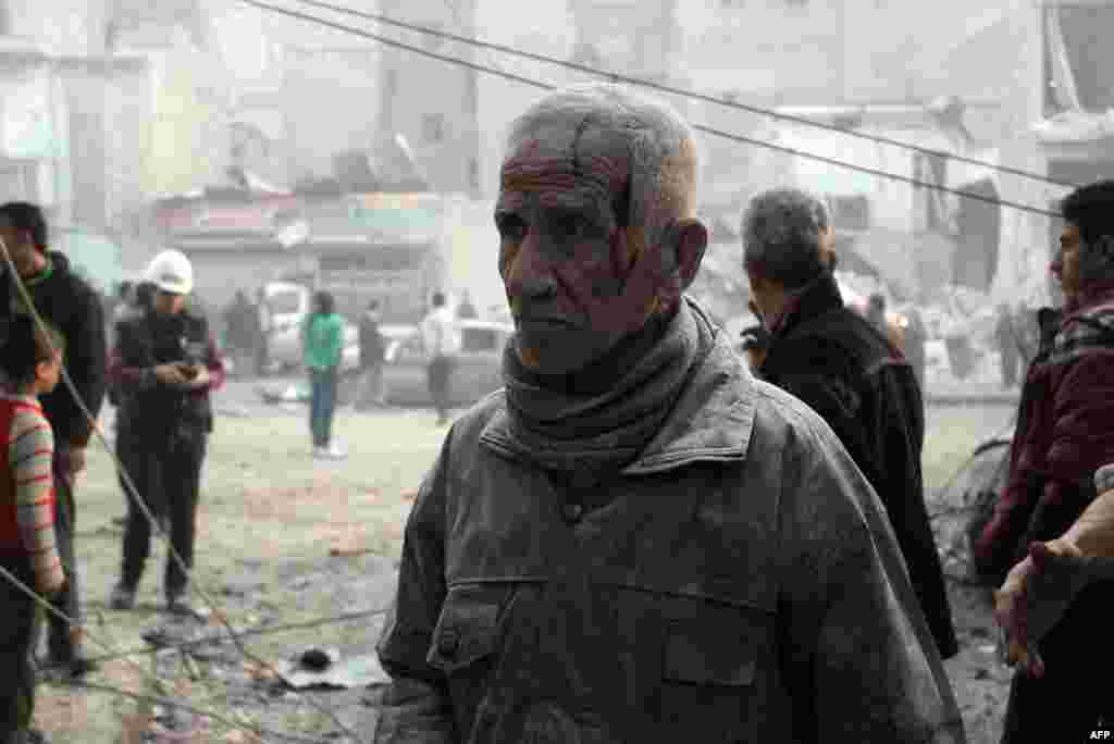 A man, injured and covered in dust, stands in a street of the northern city of Aleppo after an alleged air strike by Syrian government forces on January 29. (Topshots/AFP/Momammed Al-Khatieb)
