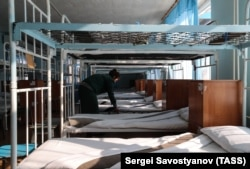 Prisoners often sleep in open barracks and eat together in large dining halls. (file photo).