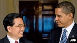 U.S. President Barack Obama (right) meets and his Chinese counterpart Hu Jintao pledged to increase cooperation.