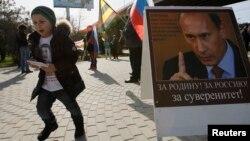 Сочиде қысқы олимпиада кезінде ілініп тұрған Путиннің постері. 23 ақпан 2014 жыл.