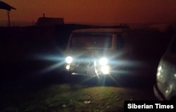 The official RFE/RL spoke to says it wasn't too dark to see, but photographs obtained by the Siberian Times show a van's headlights appearing dazzlingly bright in the orange-tinted gloom.