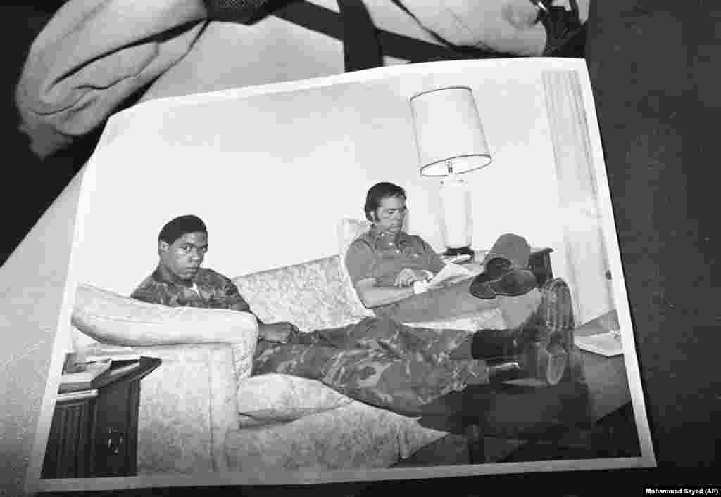 The Iranian captors took pains to show the American hostages looking comfortable. This image of an embassy staffer and a U.S. Marine was presented at a Tehran news conference on November 9, 1979. But the outside world had almost no access to the captives and, in reality, they struggled to cope. They endured beatings, a mock execution, and two would attempt suicide.