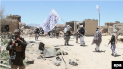 AFGHANISTAN TALIBAN CAPTURE GHAZNI -- Suspected Taliban militants patrol after they reportedly took control of Ghazni's Waghaz district, Afghanistan, 26 May 2017.
