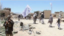 Taliban fighters patrol in the central Afghan province of Ghazni in May 2017.