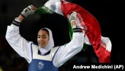 Iran's Kimia Alizadeh celebrates after winning the bronze medal in women's taekwondo at the 2016 Summer Olympics in Rio de Janeiro.