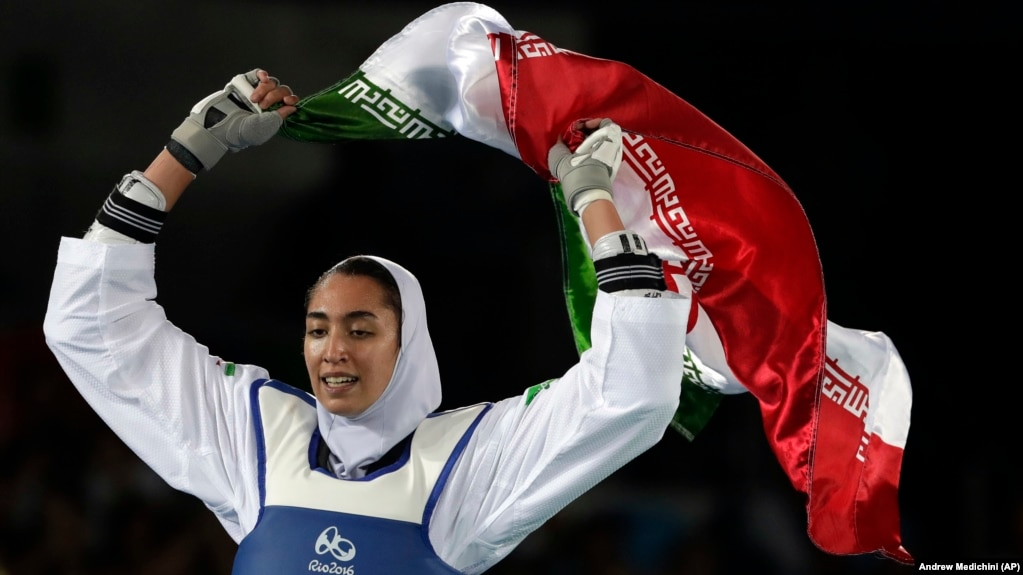 Kimia Alizadeh of Iran celebrates after winning the bronze medal in women's taekwondo at the 2016 Summer Olympics in Rio de Janeiro.