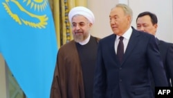 Kazakh President Nursultan Nazarbaev (right) welcomes visiting Iranian President Hassan Rohani in Astana on September 9.