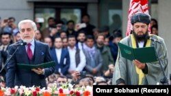 Afghan former Chief Executive Officer Abdullah Abdullah, left, and cleric Shahzada Shahid attend a swearing-in ceremony of Afghan President Ashraf Ghani (not pictured), in Kabul on March 9.