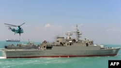 """Iran's first domestically made destroyer, """"Jamaran,"""" sails in the Persian Gulf in February."""