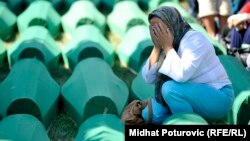 A woman weeps as a mass funeral is held on July 11 for some of the victims of the Srebrenica massacre, which resulted in the deaths of thousands of Muslim men over the course of a few days.