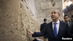 Prime Minister Benjamin Netanyahu visits the Western Wall in Jerusalem's Old City after casting his ballot.