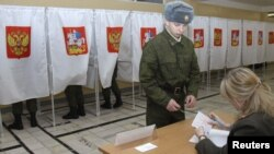 """Officials from the ruling United Russia party say the election should serve as """"a model for other countries"""" in terms of transparency."""