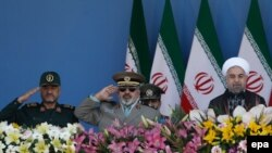 President Hassan Rohani (R), Armed Forces chief Hassan Firouzabadi (C) and Revolutionary Guard commander Mohammad Ali Jafari (2-L), attend the annual military parade marking the 1980 Iraqi invasion, September 22, 2014