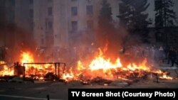 A fire burns on May 3 outside the trade union building in Odesa where dozens of pro-Russian activists died after seeking refuge amid street violence one day earlier.